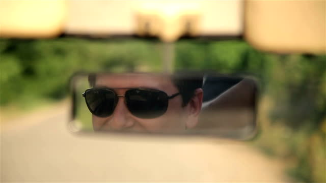in the rearview mirror car video