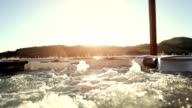 In whirlpool jacuzzi at sunset video