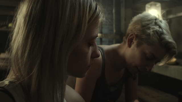 Incarcerated tattoo master tattooing blonde women at prison video