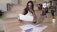 Indian business woman working with financial documents in the modern office video
