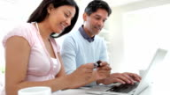 Indian Couple Making Online Purchase At Home video