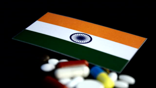Indian flag with lot of medical pills isolated on black background video