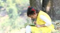 Indian girl writing on slate video