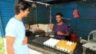 Indian man buying eggs from the shop video