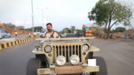 Indian man Driving an Open Vintage Jeep video
