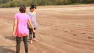 Indian Mother and Daughter playing Tic-Tac-Toe on the Beach video