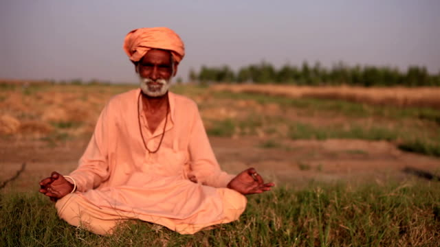 Indian sadhu doing yoga outdoor in the nature video