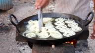 Indian Vendor making Jalebi Funnel Cake at Road side stall video