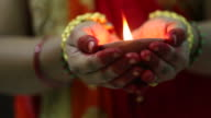 Indian woman holding Diwali oil lamp video