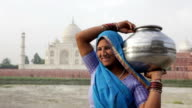 Indian Woman wearing Sari in front of Taj Mahal video