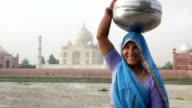Indian Woman wearing Sari in front of Taj Mahal video