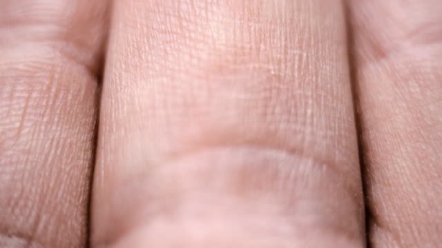 Individual pattern leather hand and fingers. Extreme closeup video