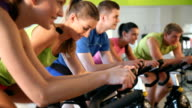 Indoor bycicle cycling in gym video