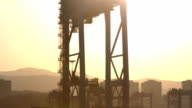 Industrial Backgrounds - Sunset View of a Big Container Crane video