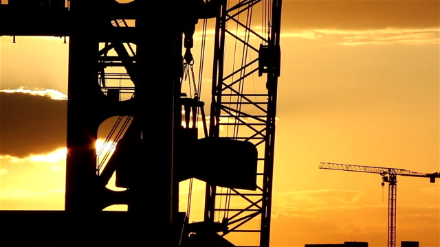 Industrial Backgrounds – Timelapse of heavy crane on sunset video