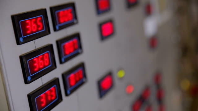 Industrial control panel with red digits on the display showing parameters video