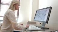 Industrial Designer designing eyeglasses on a computer video