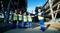 Industrial engineer and workers discussing in factory video