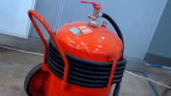Industrial, high-volume and power of red fire extinguisher on wheels video