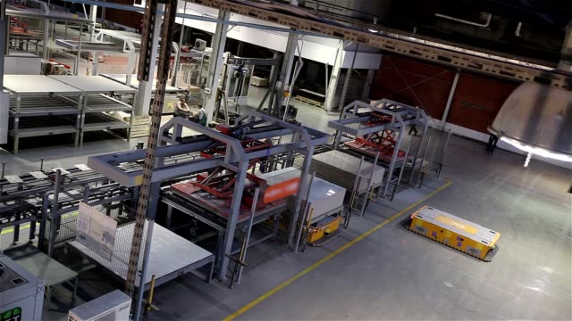 Industrial interior, production of ceramic tiles, modern factory interior, Electrical Automated Guided Vehicles Platform, time laps video
