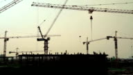 Industrial landscape with silhouettes of cranes video