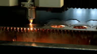 industrial laser cutter cuts metal parts in steel plant video