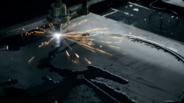 Industrial laser plasma cutting metal manufacture technology steel material with sparks video