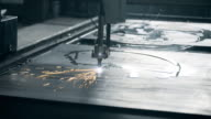 Industrial laser plasma cutting metal steel material with sparks video