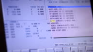 Industrial screen shows parameters. of cnc machine working video