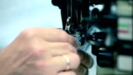 Industrial sewing machine at textile factory video