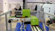 Industrial technology robotic machine for metal working on international exhibition video