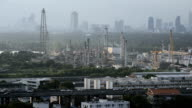 Industrial view at oil refinery plant near city video