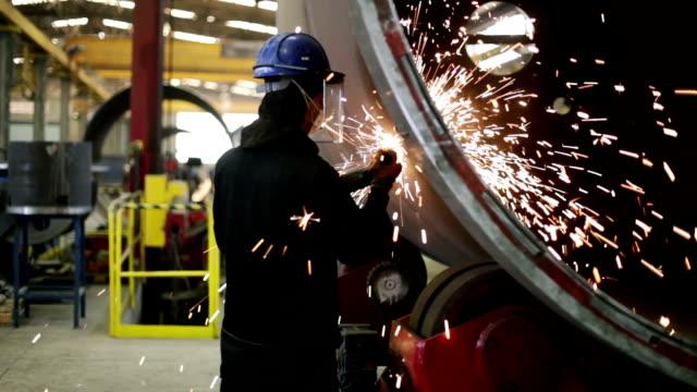 Industrial worker grinding video