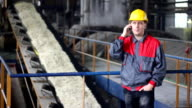 Industrial worker talking on cell phone video
