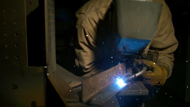 Industrial worker welding, slow motion video