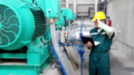 Industrial worker with notebook video