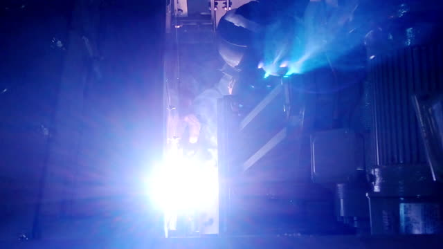 Industrial workers welding on an industrial plant. video