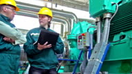 Industrial workers with a notebook video
