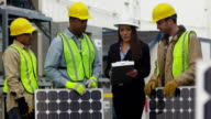 Industry workers plan solar panel installation video