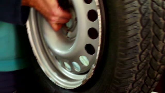Inflating and balancing car tires video