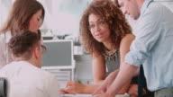 Informal business meeting in an office video