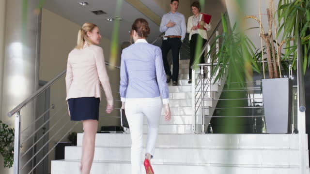 Informal business meeting on the stairs in office building video