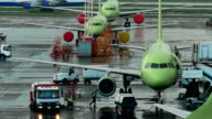 Infrastructure International Airport. Planes at the site, the staff make the necessary maintenance work video