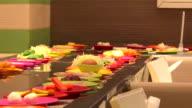 ingradient plates on rails in shabu restaurant video
