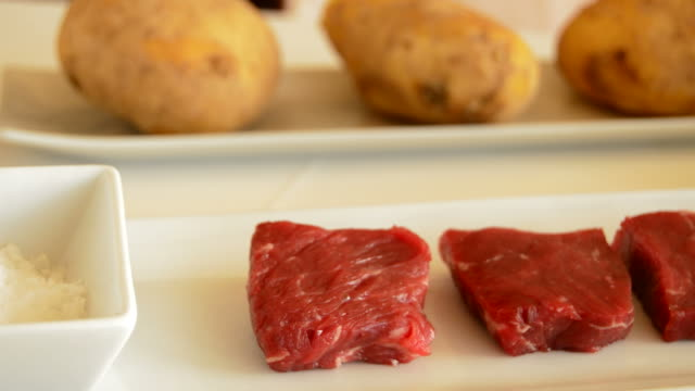 Ingredients for skewer of mango fruit and meat of cow or beef at grill panora video