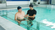 Injured man in hydrotherapy video