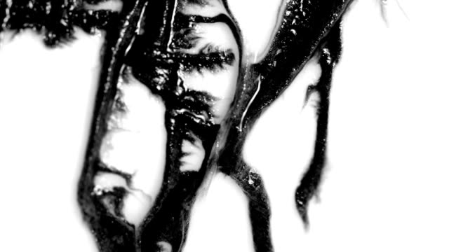 Ink blots are falling and spread. video