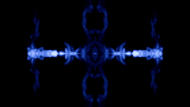 Ink kaleidoscope is abstract ink background like Rorschach inkblot test13 Ink or smoke isolated on black in slow motion. Blue tint dissolve in water. For alpha channel use luma matte as alpha mask video