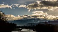 Innsbruck river power lines  end of winter time lapse video