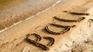 Inscription Bali on sandy beach video